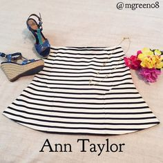 """Ann Taylor Navy Striped Skirt Ann Taylor Navy Striped Skirt. Beautiful navy and cream striped pattern. 68% polyester 31% cotton 1% spandex. Waist band has some stretch with a back zipper closure. 19"""" long. Dry clean Ann Taylor Skirts"""