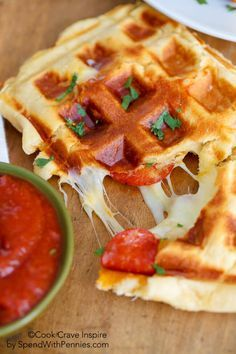 """Waffle Iron Pizza: You're only three ingredients away from pizza. And not just any pizza—each slice is """"easy, cheesy and crazy good,"""" according to the blogger."""