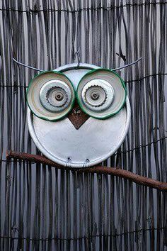 cute owl garden ornaments made from old tin lids, bottle lids, CDs, etc. Use a spoon for the nose and forks for the feet.