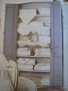 Display vintage linen in a lovely shabby chic cupboard