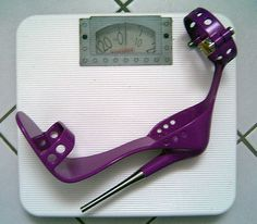 Want to practice wearing high stilettos? Try this heavy, made of metal and locking. See more on www.maxviral.com #PurpleHeel #HighHeel #Stilettos #Purple
