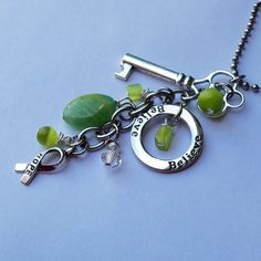 OOAK Lyme Disease, Babesia, Celiac Disease Awareness Key Charm Cluster Necklace. $30.00, via Etsy.