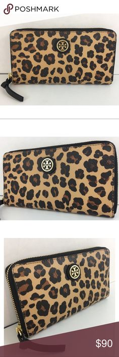 Tory Burch Kerrington Leopard Continental Wallet Tory Burch Kerrington Leopard-Print Continental Wallet. In excellent pre-owned condition. Has small mark on back (pictured). Tory Burch Bags Wallets