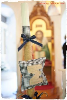 Candle for christening decorated with fabric pillow with initial letter, check fabric, natural cord and ribbon - Λαμπάδα με μαξιλαράκι με το αρχικό γράμμα, στολισμένη με φυσικό σπάγγο, ύφασμα και κορδέλα #candle #christeningcandle #handmadedecor #almanogr #λαμπάδα Easter, Candles, Blog, Candy, Candle, Pillar Candles, Lights