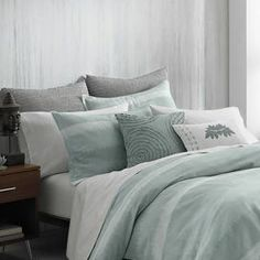 """Crafted from organic cotton, this lovely pillow sham showcases an ombre-inspired design in mineral blue for a touch of serene style.   Product: ShamConstruction Material: Organic cottonColor: Mineral blueFeatures: 230 Thread countDimensions: Standard: 20"""" x 30""""King: 20"""" x 40""""Note: Sham is pictured on the second row pillow. Insert not included. Cleaning and Care: Machine was warm with like colors. Tumble dry low. Do not bleach."""