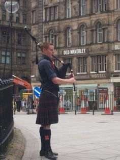 Bagpiper on streets of Edinburgh. I took picture.