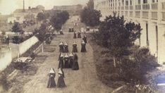 Ursuline nuns gather on the lawn, between the river and the main building, at their second convent in New Orleans' Ninth Ward. Photograph taken sometime in the late 1800s by Mother St. Croix.
