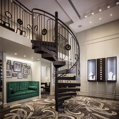 Art Deco inspired Mondial jewellery store in the Strand Arcade Sydney by Lawless and Meyerson with custom iron spiral staircase and Catherine Martin carpet.