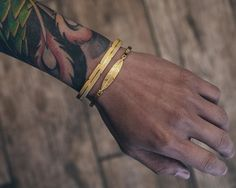 Double stacking with The Feather Cuff and The Axle Feather Bracelet in Gold - available in four finishes at www.mrsfc.com #mistersfc #accessoriesforsale #accessoriesoftheday #accessories #bracelets #braceletsoftheday #braceletsforsale #braceletsformen #braceletstacks #jewelryforsale #jewerlydesign #jewelryoftheday #jewelryswag #jewelry #jewelrygram #jewelrydesigner #goldjewelry #goldaccessories #goldbracelet #qualtiyalways