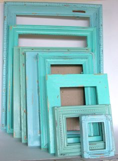Old frames. Different sizes, painted different sea colors. Could frame your own shells glues to a mat.. or sea glass glued to a mat.