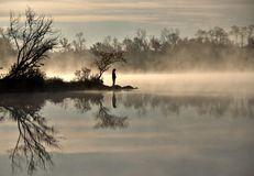 Mist on the lake at sunrise Royalty Free Stock Photos