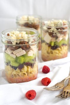 Sonoma Chicken Pasta Salad Jars - Portable and delicious lunches packed with pasta, dried cranberries, celery, chicken, pecans, blue cheese and homemade raspberry vinaigrette.