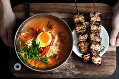 Chilled kimchi broth and buckwheat noodle, with grilled pork belly skewers.