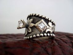 Western Wedding Ring, I love this  Same minus the thing sticking out