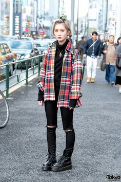 black jeans. sweater layered with a flannel. all black except for the shirt.