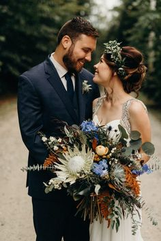 Hosting a winter wedding? You'll need some winter wedding flowers! Here are 23 winter wedding bouquets and tips on how to make your own. Protea Wedding, Tulip Wedding, Winter Wedding Flowers, Fall Wedding Bouquets, Flower Crown Wedding, Fall Flowers, Altar Flowers, Bridal Bouquets, Bouquet De Protea