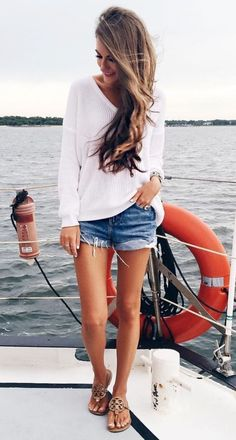 vacation outfit inspiration white top plus sandals plus shorts