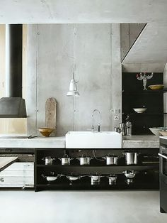 kitchen inspiration - concrete, black open shelves, farmhouse sink /