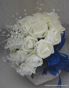 Brides Bouquet. Ivory rose diamante, crystal stems and butterfly, shown here with royal blue handle and bows...