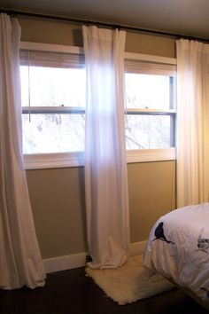 Sheets to curtains.....also use sheets in bath for decorative shower curtain.  Double the sheets with dark color sandwiched for room darkening.