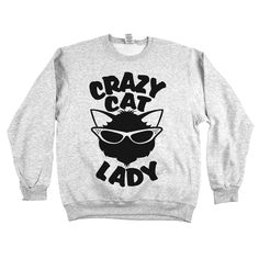 """Not sure how many cats is takes to qualify as an official 'Crazy Cat Lady.' One? Two? Three? Hmmm . . . you decide while wearing our """"Crazy Cat Lady"""" women's apparel!"""