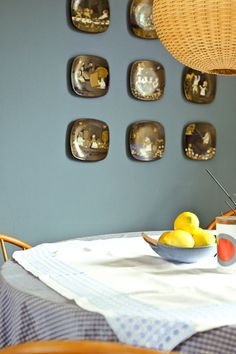 plates from arabia/ finland on blue wall at boris zbikowski's vintage apartment