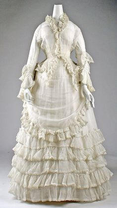 Circa 1871 cotton Afternoon dress, European.  Love all the ruffles!