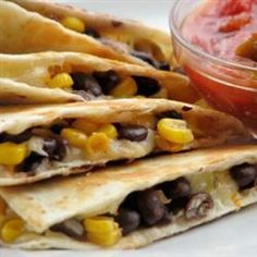 Black Bean and Corn Quesadillas.... I'd add some cuban chicken in it also.