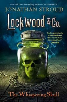 The Whispering Skull- (BOOK)-Lockwood & Co. are hired to investigate Edmund Bickerstaff, a Victorian doctor who reportedly tried to communicate with the dead, while Lucy is distracted by urgent whispers coming from the skull in a ghost jar. Repeatedly targeted by Quill Kipps and his team of Fittes agents in the months after surviving a night in England's most haunted house, Anthony, Lucy and George attend the exhumation of a Victorian doctor.