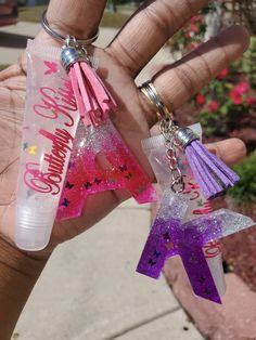 Handmade letter keychains made with resin and beautiful laser cut butterflies. Handmade all natural lip gloss. Our lip glosses are long lasting, moisturizing, and non sticky. Best Lip Gloss, Diy Lip Gloss, Lip Gloss Colors, Diy Resin Art, Resin Crafts, Tape Crafts, Rose Von Jericho, Gloss Labial, Lip Gloss Homemade