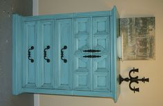 Vintage turquoise chest of drawers with black glaze