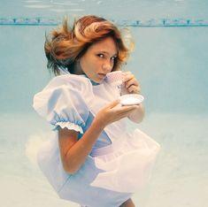 Underwater photographer Elena Kalis, in a great Alice in Wonderland shoot.