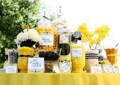 Maybe black and yellow/sunflower theme for anniversary party?? This is a cute candy table... although I want to do a dessert table.