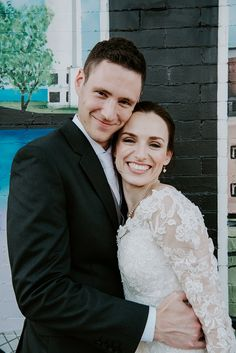 such an adorable couple! the illusion lace sleeves are so pretty on the bride's Sophia Tolli Gabrielle gown.