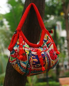 Red Colored Elephant & Flower Embroidered Banjara Bag Rs. 1186  Our price is inclusive of GST taxes Elephant and flower printed banjara bag has the comfortable strap to hang on the shoulder. The work is on both sides of the bag.  size -  Lenght: 11 inches  Width:21 inches
