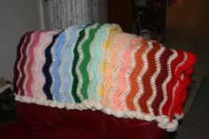"""Except for two skeins, this yarn was all gifted to me.  This is my loose take on a """"Roy G Biv"""" baby afghan.  It's for the big sister of that baby that is coming to friends in Feb. 2014.  Love the ruffled edge, but it's a real """"yarn gobbler!"""""""
