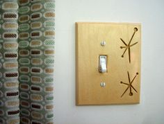 Atomic LIght Switchplate Mid Century Modern Gold FREE SHIPPING USA. $18.00, via Etsy.