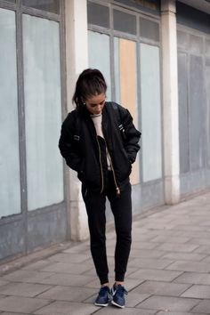 Fashion blogger 'India Rose' - black bomber jacket, Nike sneakers, backpack