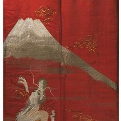 Kimono, 1850-1880. Museum no. T. 72-1957. This kimono has been embroidered with an extremely potent image of dragons, the most powerful of the mythical beasts, and Mt Fuji, the quintessential symbol of Japan. The striking red silk ground makes the image all the more dramatic.Yet this is an under-kimono (juban), so its design would not have been seen when worn. Instead it served to symbolically wrap the wearer with divine power and protection.