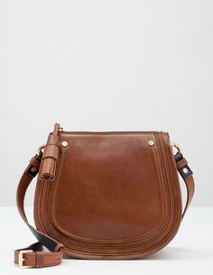 With its sweet crescent shape, tassel zip and textured buttery leather, this cross body bag is a stylish all-rounder. Just big enough for the essentials with internal pockets, we'd say it was the perfect day (or night) companion…. Saddle Handbags, New Handbags, Leather Saddle Bags, Mode Style, Clutch Wallet, Fashion Bags, Women's Accessories, Messenger Bag, Purses And Bags