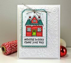 For my card I used the Hero Arts stamp set Sending Holiday Cheer.  I started out with a white card base, then a snowflake embossed panel and then my tag which I matted using a piece of My Mind's Eye Winter Wonderland designer paper.  The house was colored using Copic markers and to finish off my card I tied on some silver cording and added some glitter to my image.