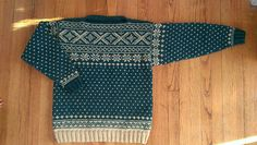 A traditional-style Norwegian ski sweater, worked in two colors. Available from toddler to adult XL sizes. This sweater is meant to be slightly oversized, and it is recommended to knit it with up to 4 inches of ease. It is also quite long.