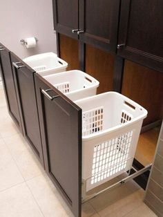 hamper idea for laundry room. Could have flat  cutting board-type pull outs between the upper and lower cabinets if need be, to provide folding space. Also could include a pull out bar normally used to hang your dry cleaning in your closet.