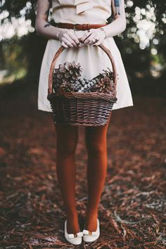 inspiration | have your bridesmaids carry baskets full of pine cones, fruit, or flowers for a rustic fall wedding | via: finch and fawn