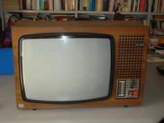 Half my life was spent watching TV's like this.....And constantly being told not to sit too close or I'd go blind lol