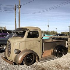 really awesome vintage COE truck with half ton pickup bed on the back and clearly functional lake pipes.