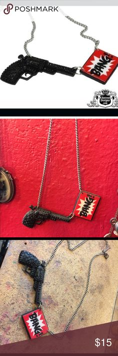 Pinup Girl Clothing Bang gun necklace funny Necklace purchased from Pinup Girl Clothing around 5 years ago. Black gun and red Bang sign on a silver chain. This necklace is a fun conversation piece, I wore it to work a good amount when I bought it and people always thought it was funny. Pinup Girl Clothing Jewelry Necklaces