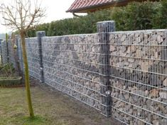 Wooden Fence On Metal Posts Gray Front Yard Fence.City Of Austin Front Yard Fence. Gabion Fence, Gabion Wall, Brick Fence, Front Yard Fence, Metal Fence, Fenced In Yard, Bamboo Fence, Fence Planters, Stone Fence