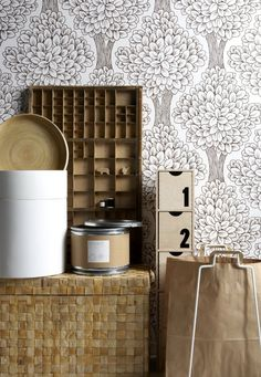 Eclectic and simple vignette with natural wood &fiber color with white, squares with round tree pattern wallpaper and containers |  Andrea's Blog - Top 5 Tips for Styling Vignettes