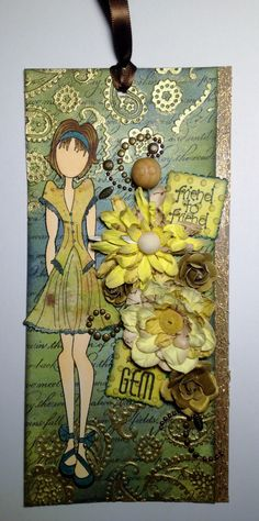 I fell in love with the Prima Marketing Mixed Media Doll stamps when I saw someone at a crop using them. She is colored with Copics and her dress is paper pieced. The background started out as 110# white cardstock from Hobby Lobby, add a little Tim Holtz Distress Ink, Tattered Angels Glimmer Mist, bling and flowers and you've got yourself a pretty nice custom tag.